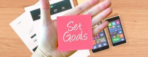 The words 'Set Goals' next to a mobile phone